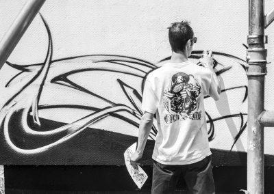 Graffiti Street art Zert en action sur la façade de la tour misaine en 2015 à Aix les Bains (73)